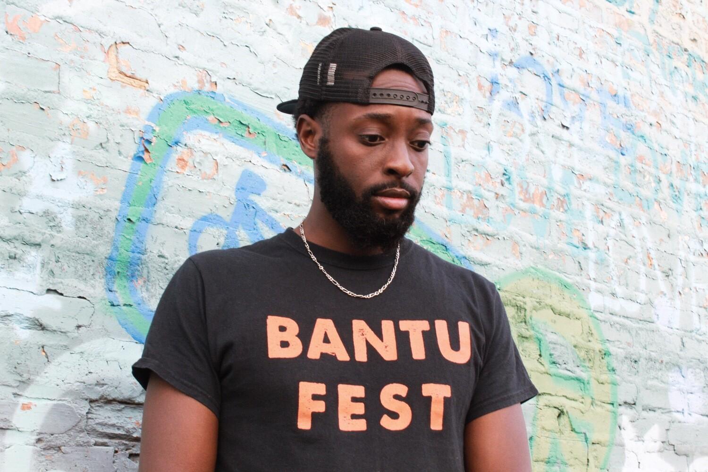 Bantu Fest Orange on Black Tee (Unisex)