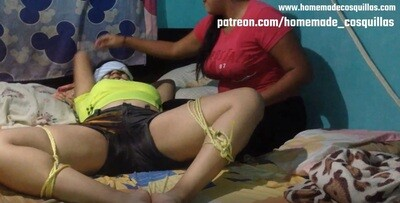 Gaby tickled by her sister and Paola