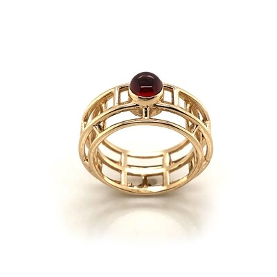Caged.  14k and garnet ring.