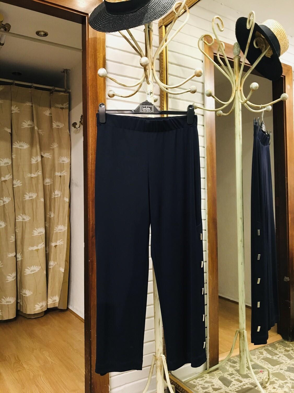 Pantalón con tachuelas