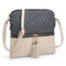 Monogram Color block Tassel Zip Crossbody Bag; beige/black
