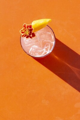 Pink Cocktail With A Side Of Orange