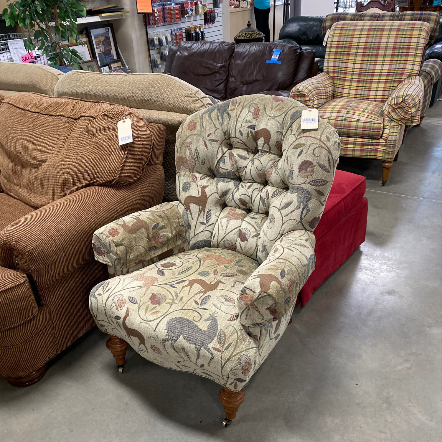 BROWN GREEN CHAIR W/ROLLERS IN THE FRONT