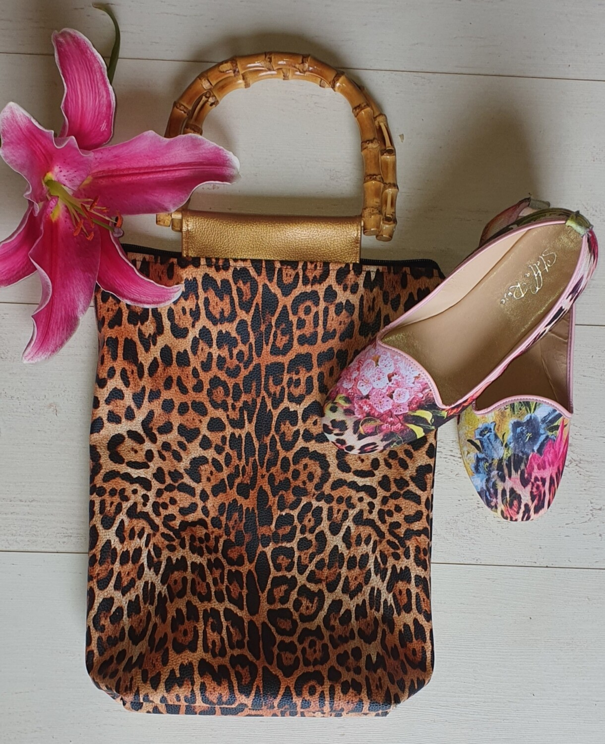 Leopard print bamboo handle bag