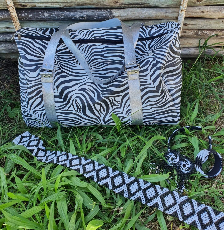 Barrel overnight bag in faux Zebra print.