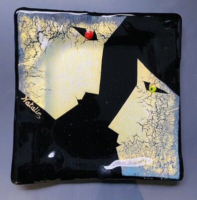 """Faces gold on black. 8.5""""x8.5"""""""