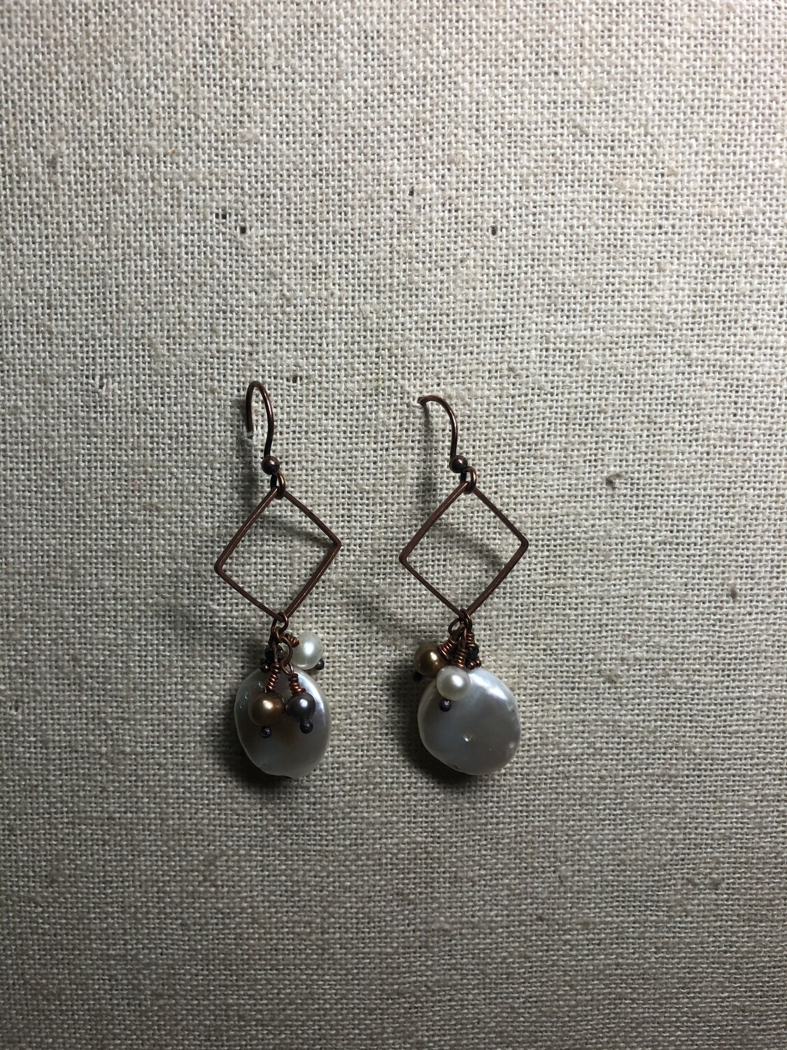 Rustic copper and. pearls.