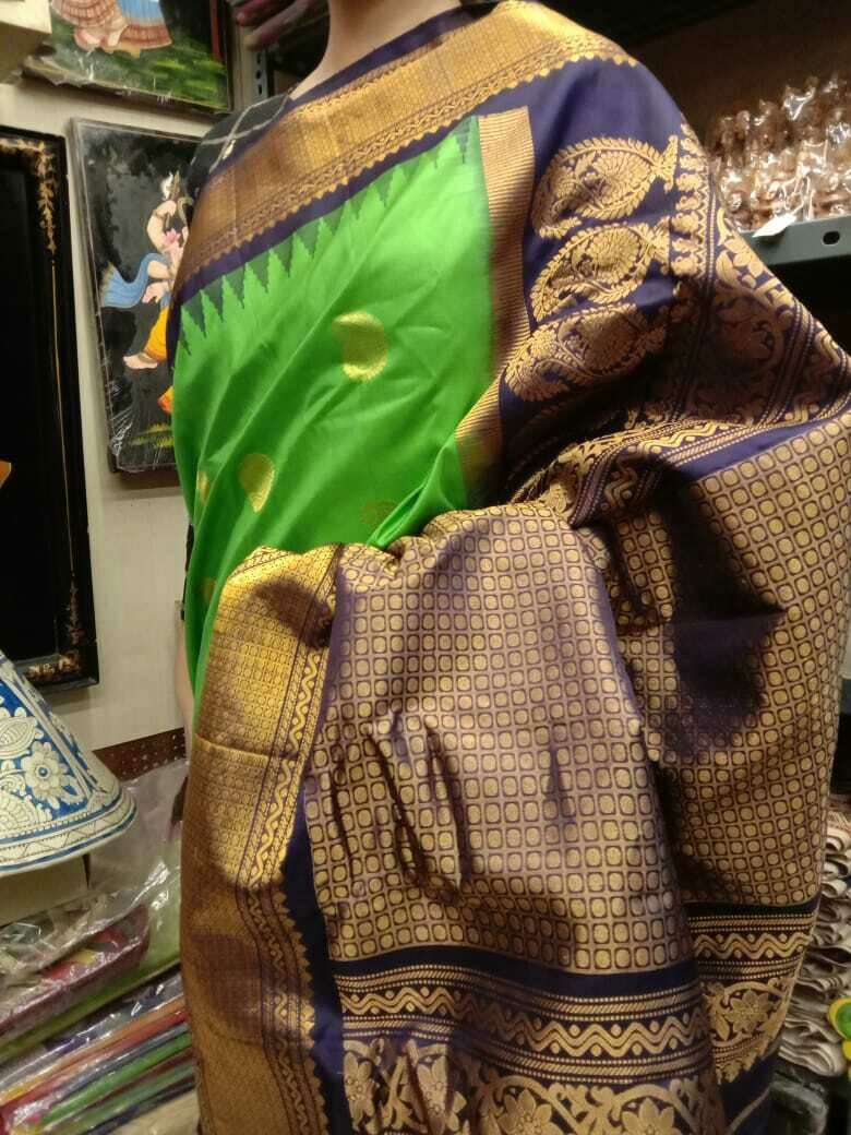 Handpicked Gadwal Premium Saree in Parrot green and Purple