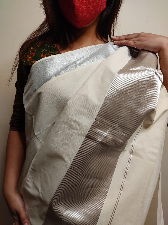 Sundori Kerala Cotton saree in White and silver Zari work