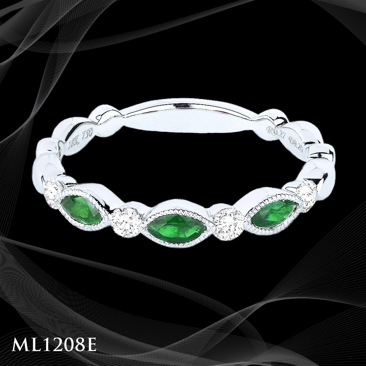 14 Karate white gold emerald and diamond ladies fashion ring.