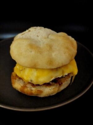 SAUSAGE, EGG & CHEESE ON HERB BISCUIT