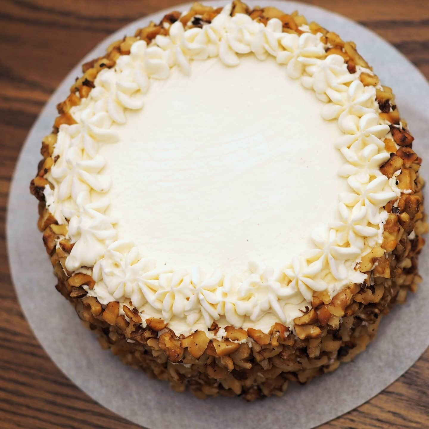 Vegan carrot cake with cream cheese frosting and roasted walnuts. GLUTEN FREE available.