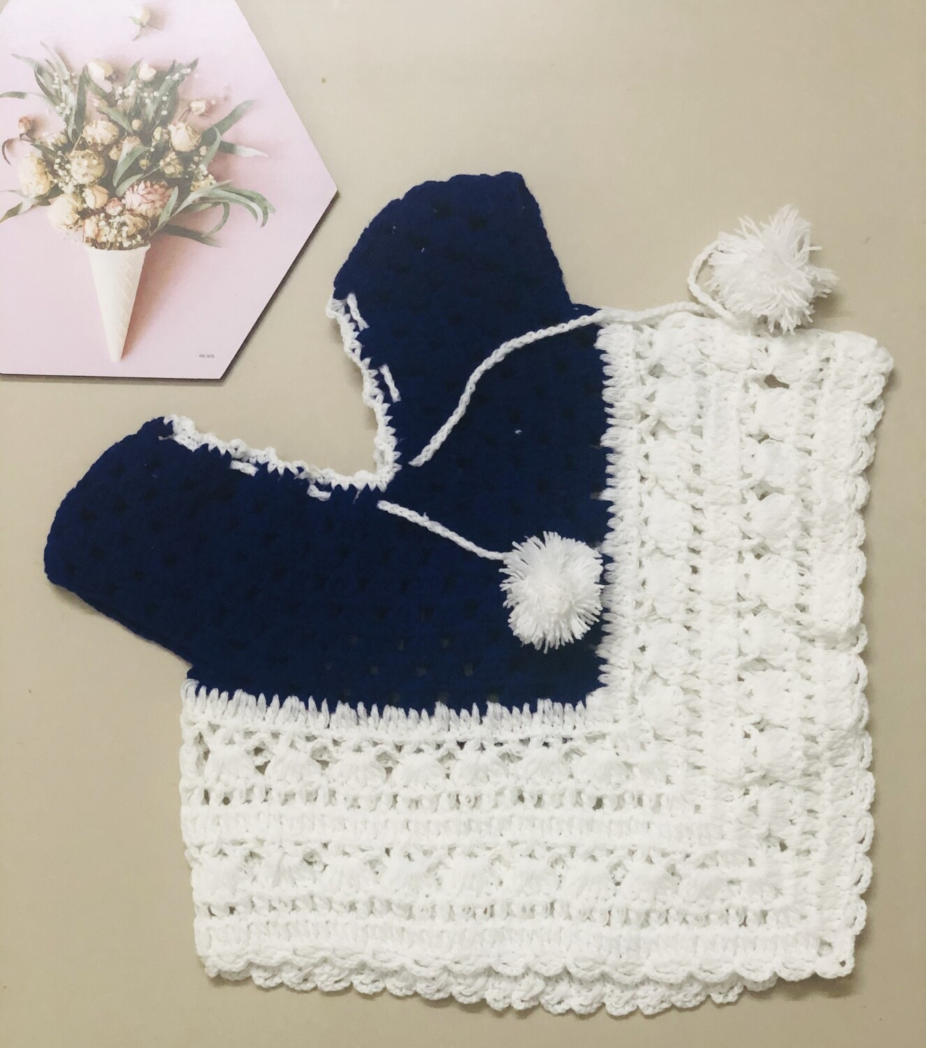 White and blue poncho
