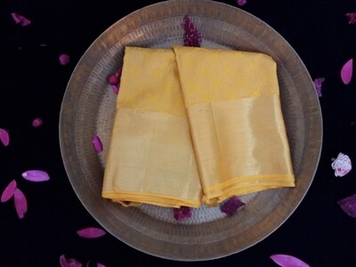 Glaze yellow and gold shade kanchi saree comes with gold border