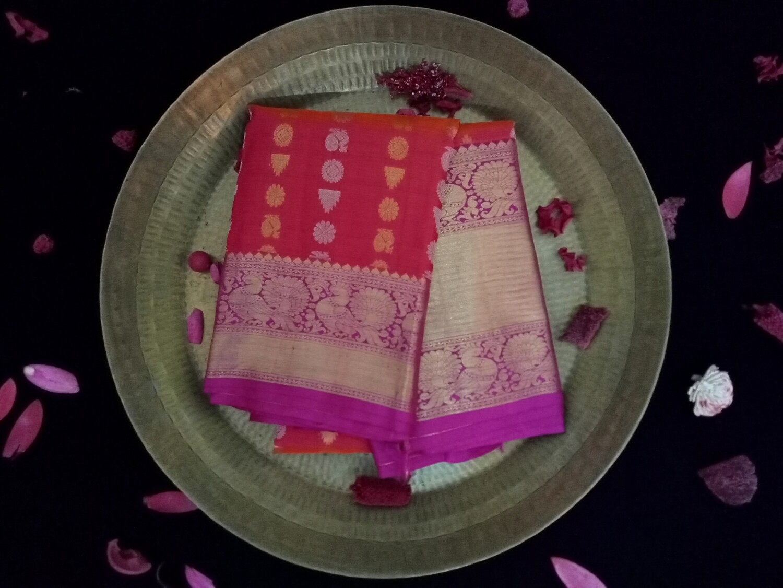 Squash orange with red shaded kanchi saree along pink and gold border