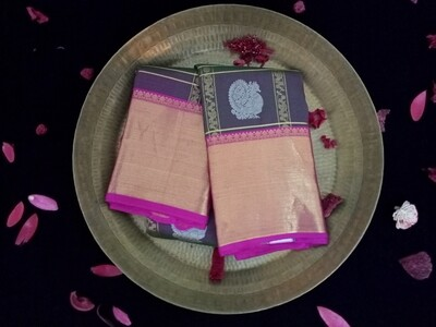 Olive green shade with orchid color kanchi saree comes along pink and gold border
