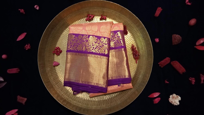 Peach kanchi saree with purple and zari border
