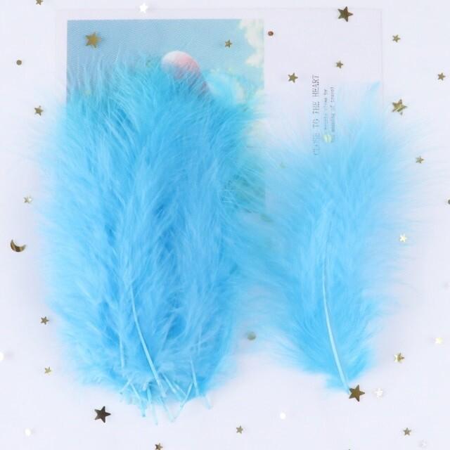 Перья марабу голубые 15 шт.