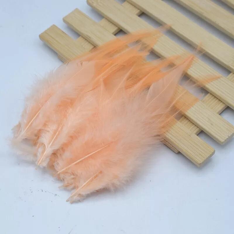 Перья петуха персик 10 - 15 см. 20 шт.