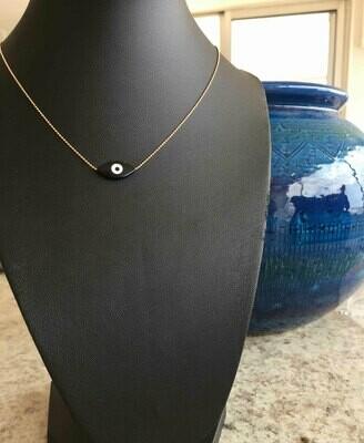 Gold necklace eye shaped pendant