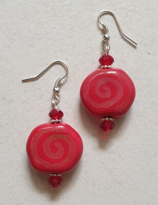 Hand glazed ceramic red spiral earrings