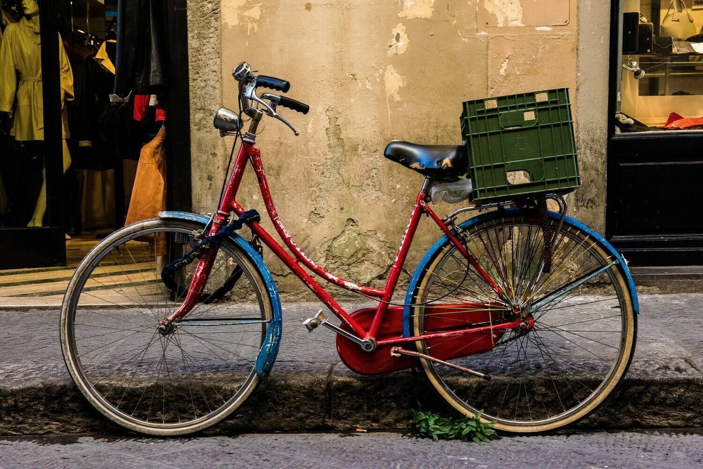 "Red bike - 12"" x 8"" in a black 16"" x 12"" mount"