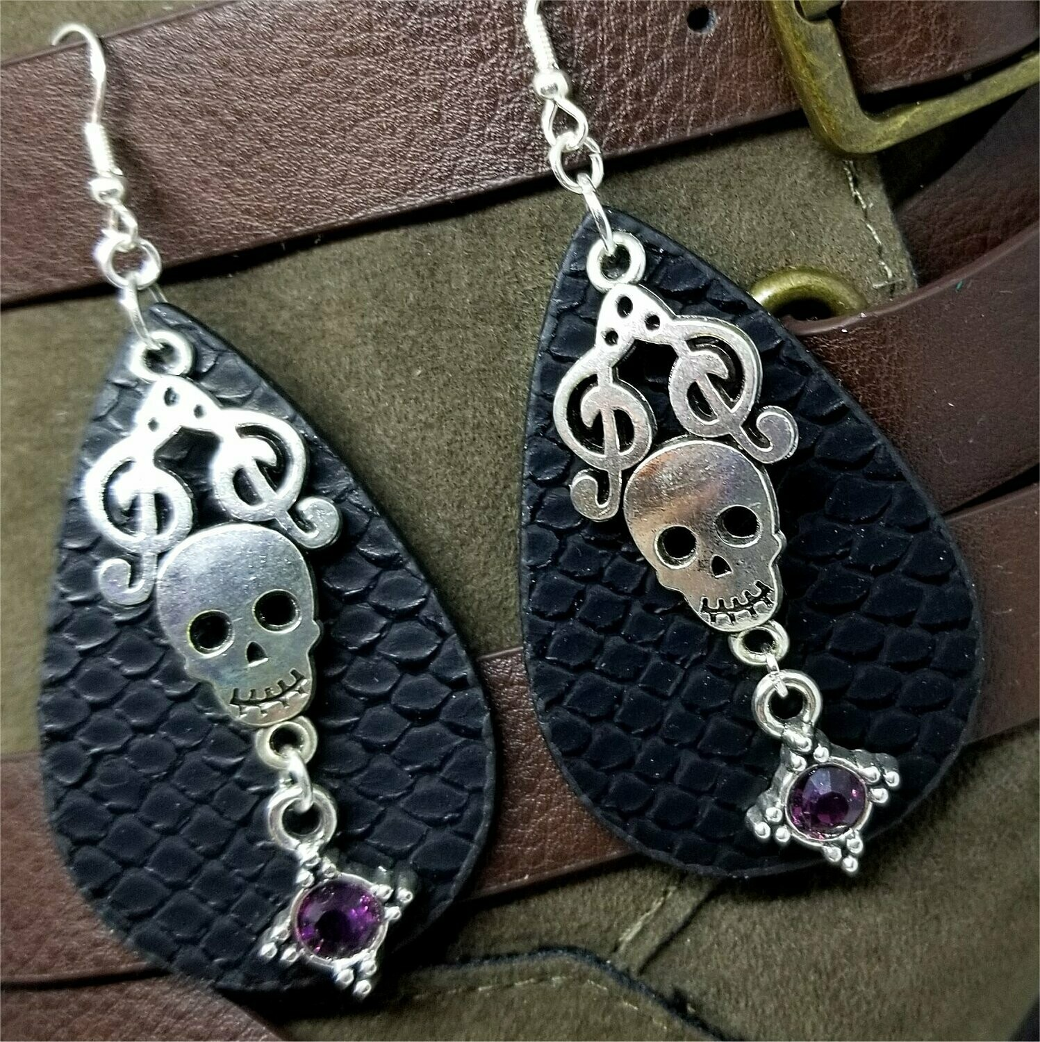 Patterned Faux Leather Teardrop Shaped Earrings with a Skull and Clef Note Charm and Crystal Charms