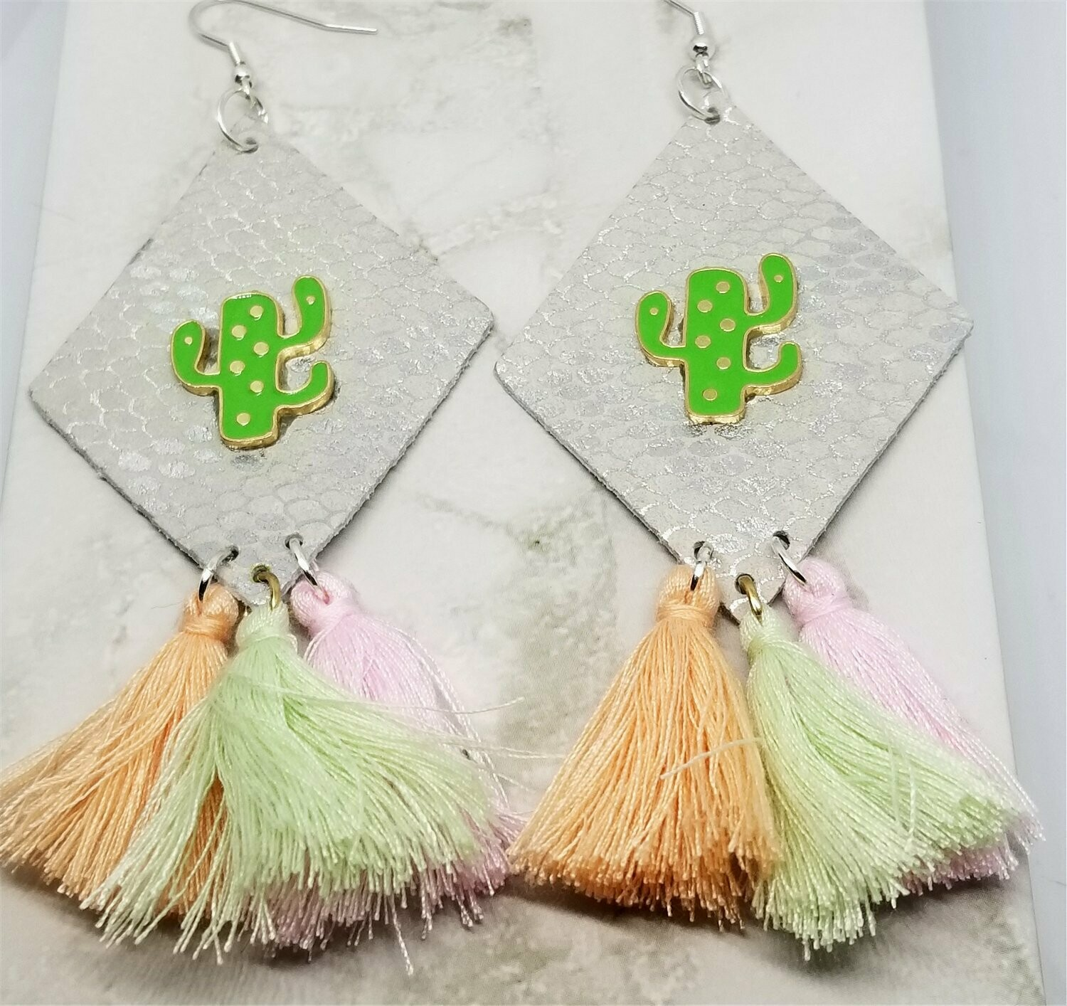White and Silver Diamond Shaped Real Leather Earrings with String Tassels and a Metal Cactus Embellishment
