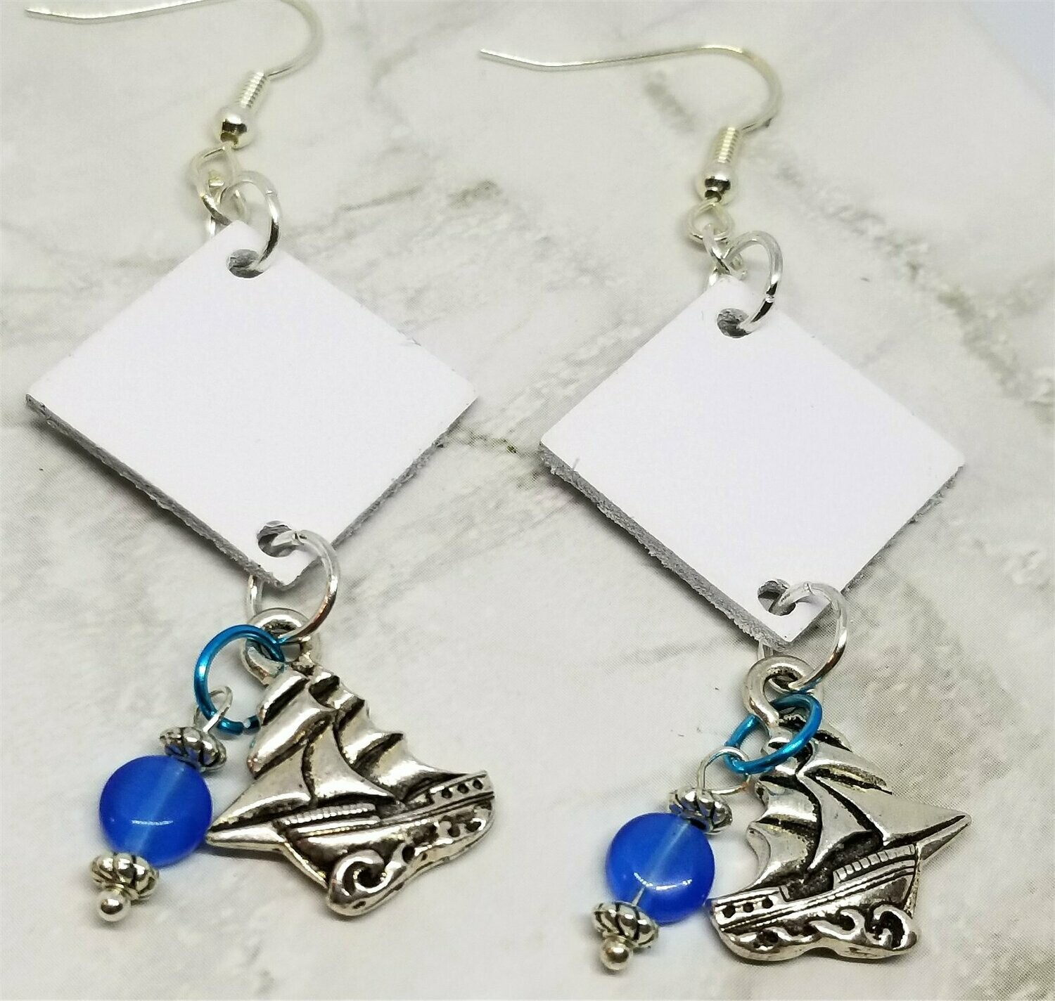 White Diamond Shaped Leather Earrings with Sailboat Charms and Glass Beads