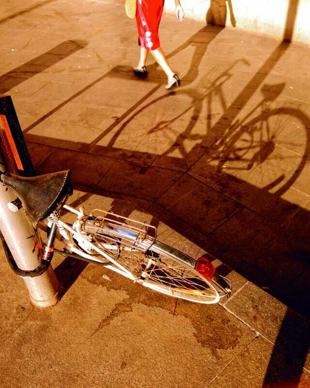 Bike shadow and woman passing by.Universo Fran.