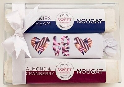 One soft caramel toffee, beautifully wrapped and packaged in Love themed wrapper with two assorted luxury nougats, packaged in a gift box with ribbon.