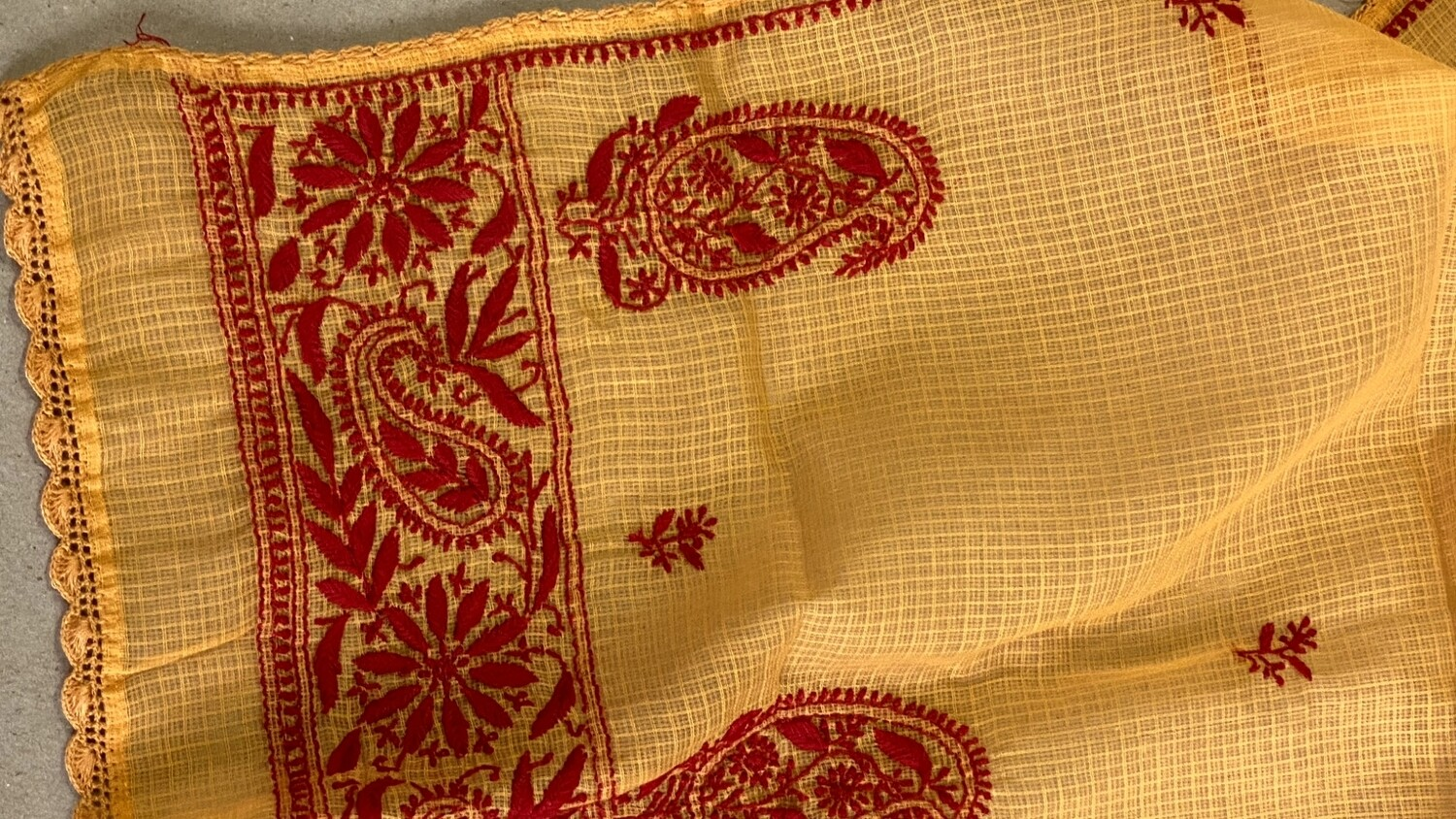 Red hand embroidery on orange kota stole