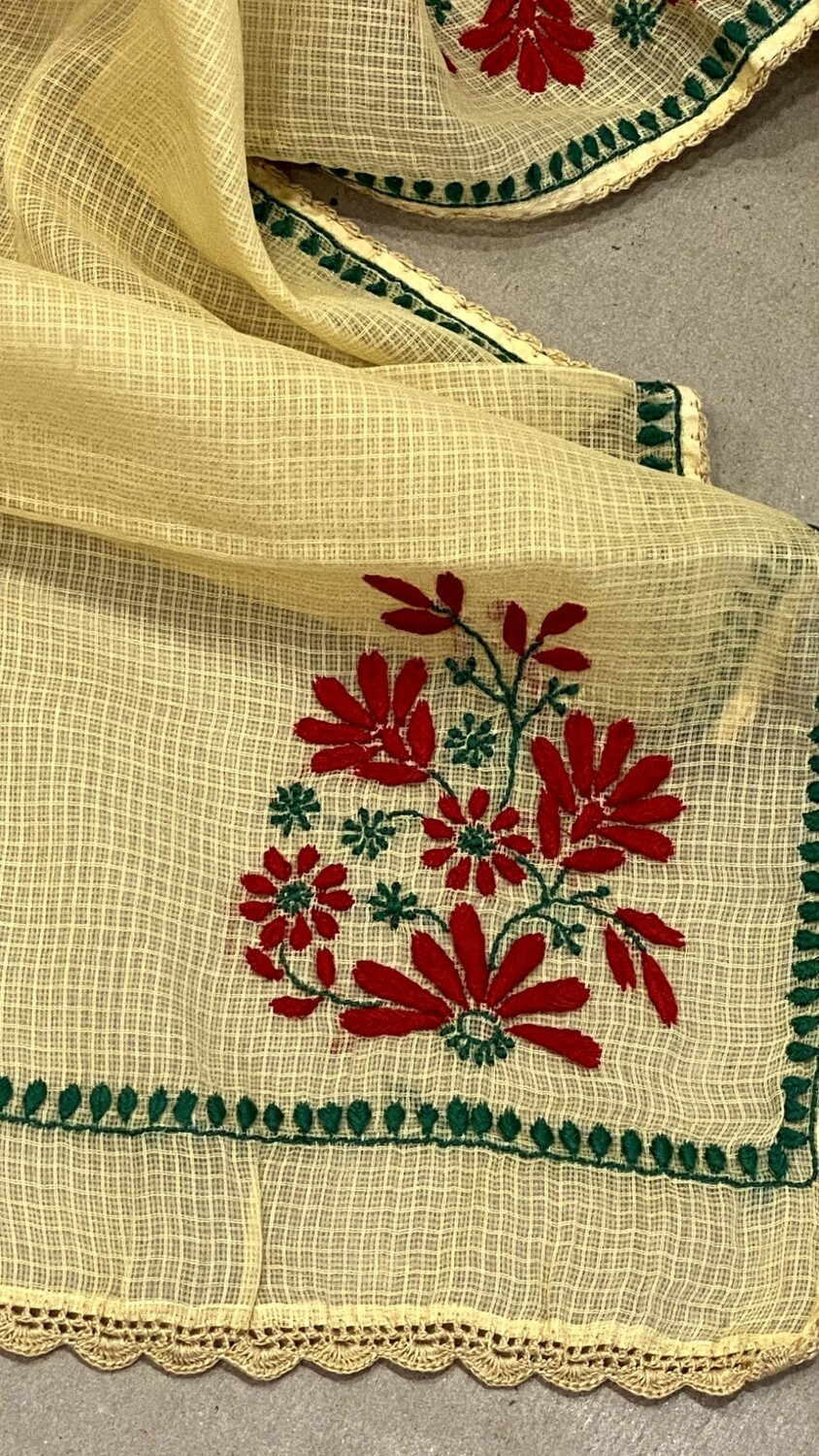 Red and green flower design on beige kota stole