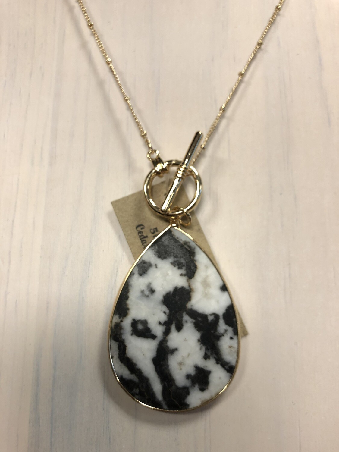 Black/White Teardrop Stone Pendant on Long Gold Chain