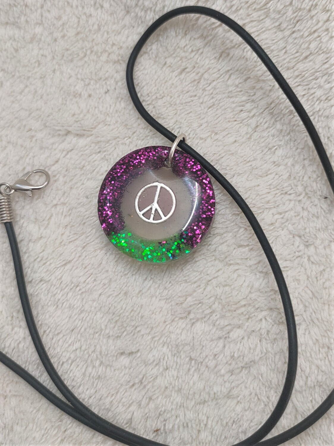 Glow in the dark peace sign pendant