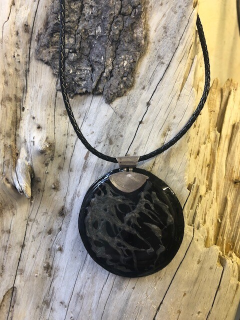 Round leather black pendant