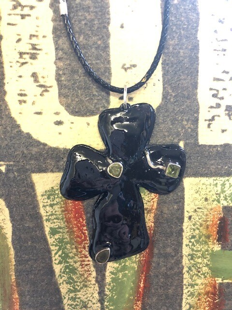 Leather wrapped cross with silver and peridot embellishments