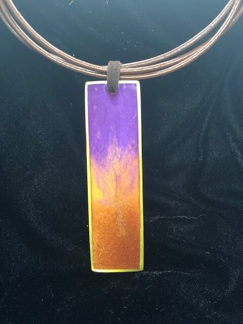 Purple and orange resin pendant