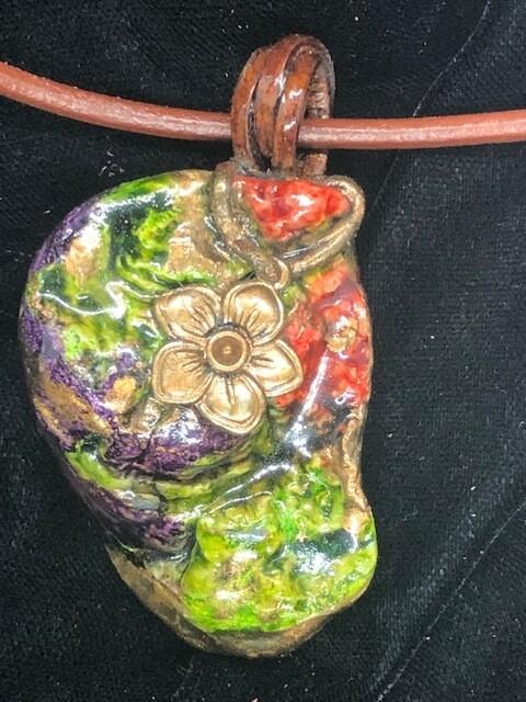Shell pendant with flower embellishment