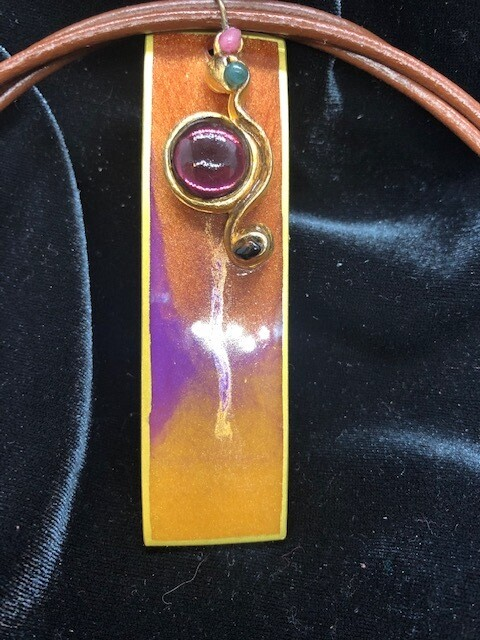 Beautiful resin pendant in warm tones