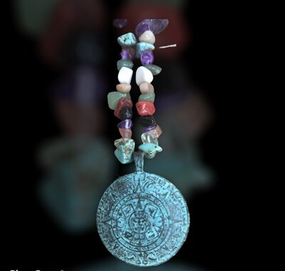 Greek antique looking pendant on gemstone necklace