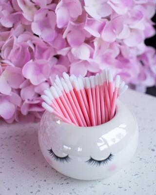 Pink applicator brush