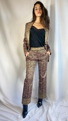 Pantaloni disegno fantasia oro