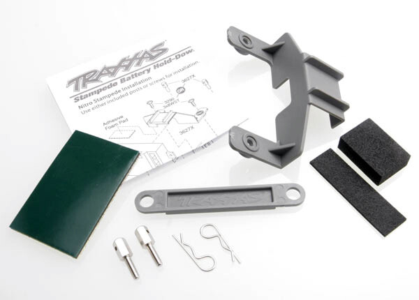 Battery hold-down (gray) (1) / receiver hold-down (grey) (1) / metal posts (2)/ spacers (2)/ body clips (2)/ servo tape/ adhesive foam pad