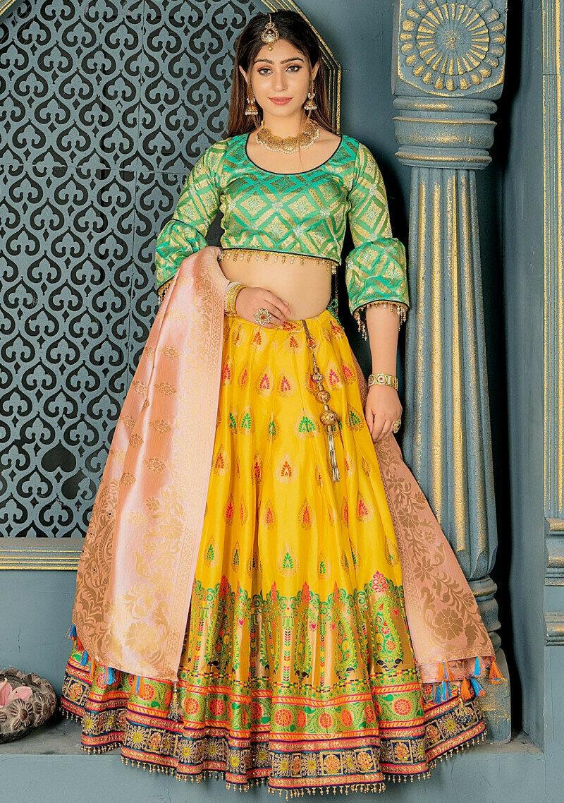 glossy yellow heavy embroidered banarasi silk lehenga choli