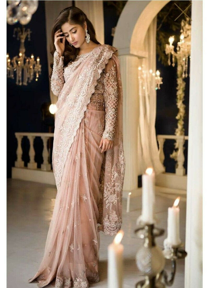 New Launching Superhit Designer Peach Bollywood Saree Collection