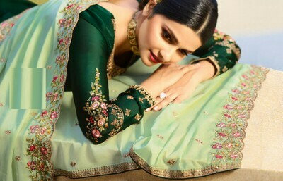 Green  Colored  Salwar  Suit With  Embroidery Work