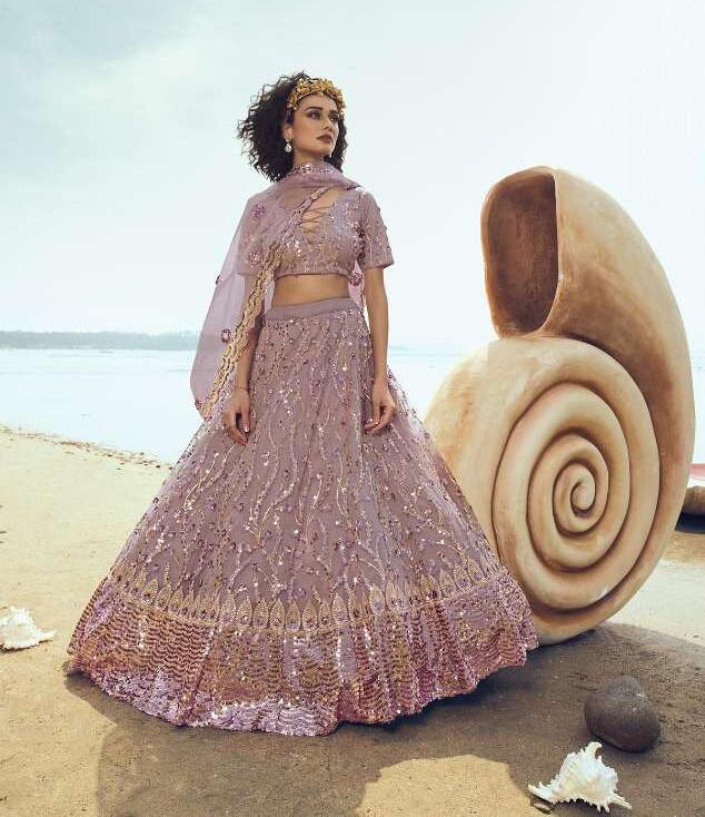 Beautiful Sequins Embellished Soft Net Lehenga Choli In Liliac