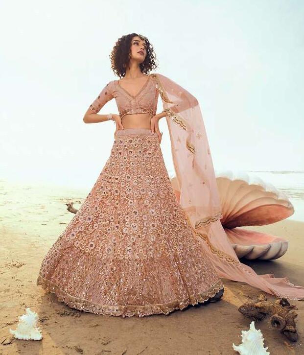 Sequins Embellished Soft Net Lehenga Choli In Peach