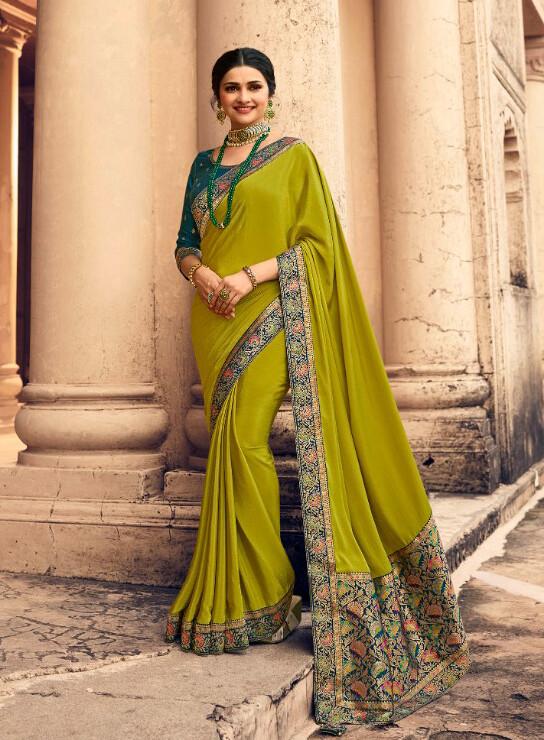 Banaras Border Pallu Silk Crepe Saree In Parrot Green
